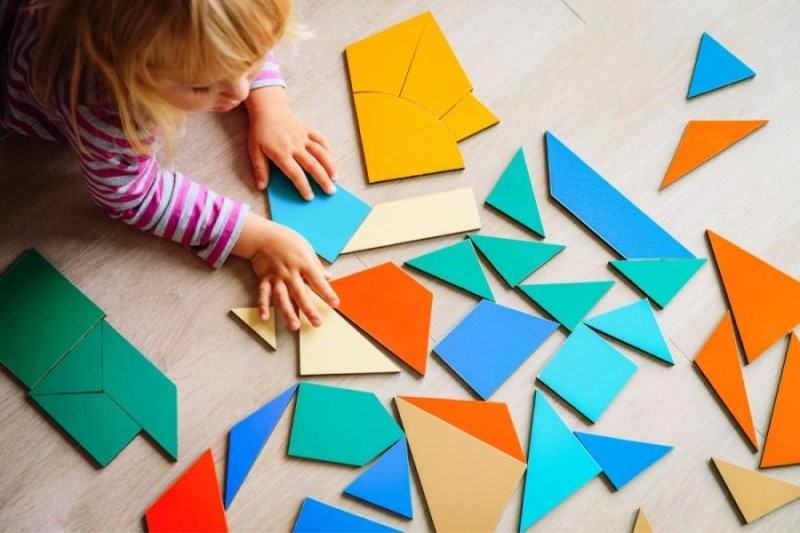 child at daycare with blocks, things to do before moving to Portland OR, Real Agent Now