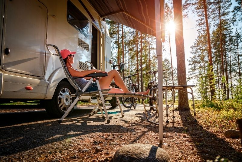 girl relaxing outside of a camerpvan, How much does it cost to live in Portland Oregon