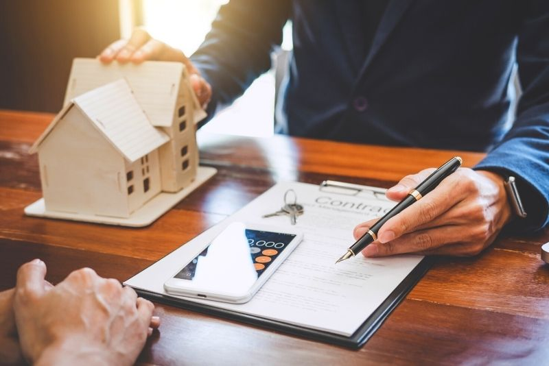 image of man showing home contract, Top 5 Relocation Tips for Moving to Portland Oregon