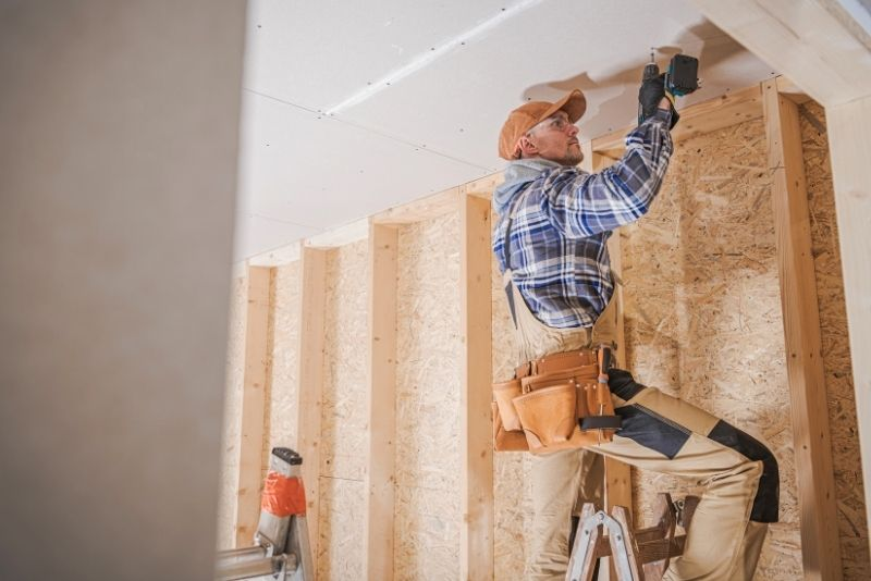 man doing construction inside, Everything to know about ADU's in Portland Oregon