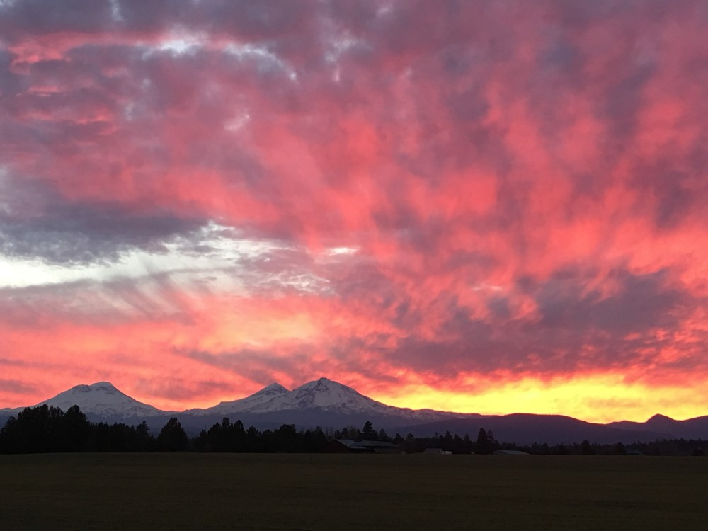 sunset over Bend OR, cost of living in Bend Oregon (1)