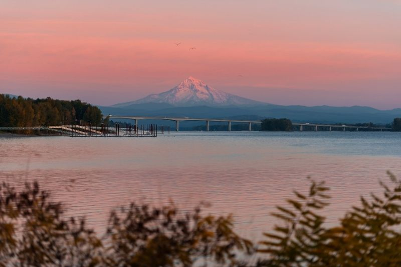 view of Mount Hood over water at sunset, Most Asked Questions about Moving to Portland Oregon