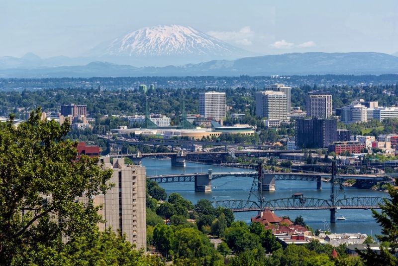 view of Portland Oregon bridges on the Willamette River, How much does it cost to live in Portland Oregon
