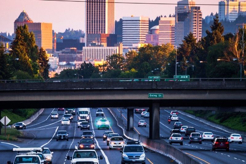 view of a traffic commute with Portland Oregon in the background, Most Asked Questions about Moving to Portland Oregon